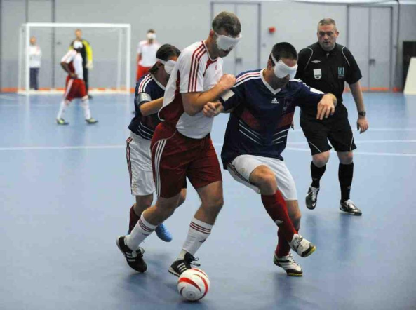 Blind football referee